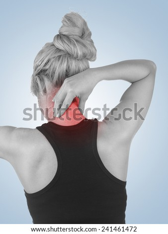 Pain in woman neck. Female holding hands on spot pain neck. - stock photo