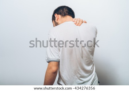 Pain neck. The back man - stock photo