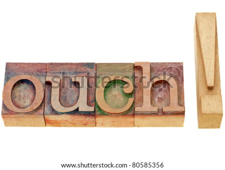 pain or surprise concept - ouch - isolated exclamation word in vintage wood letterpress printing blocks - stock photo