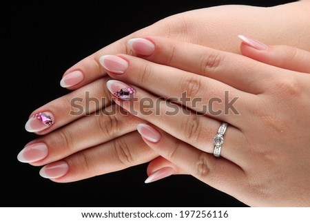 pained nails and hands isolated on black background