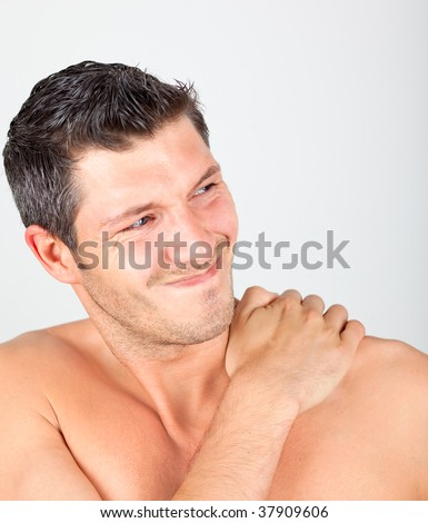 Painful physical masculine face expression - stock photo