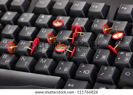 Painful typing, pins on keyboard close-up - stock photo