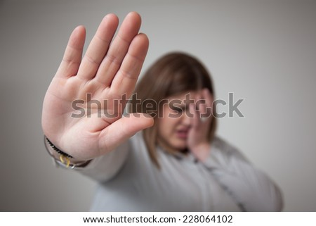 Painful woman saying stop with her hand.