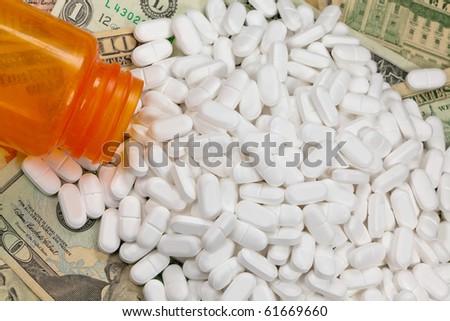 Painkiller, prescription drugs, money - stock photo