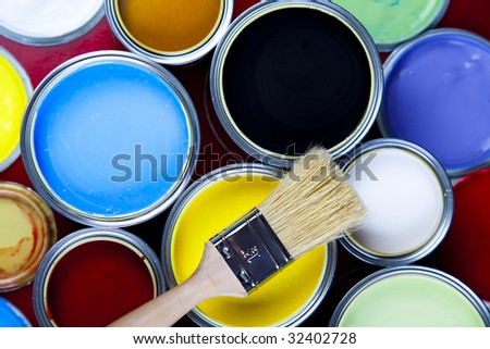 Paint brush and cans - stock photo
