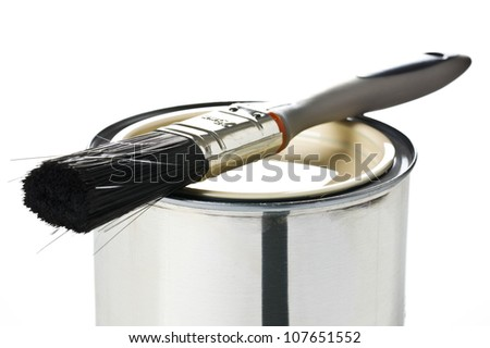paint brush and tin can on white background