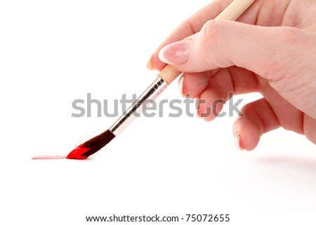 Paint brush in hand isolated on white