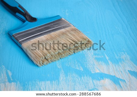 Paint brush on a blue background