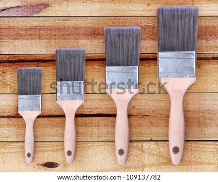 paint brush  on crackle wooden background - stock photo