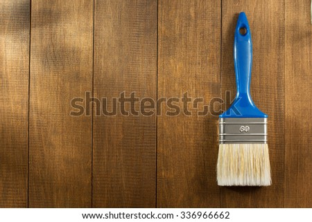 paint brush on wooden background - stock photo