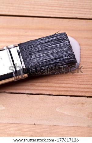Paint brush resting on paint tin viewed from above  - stock photo