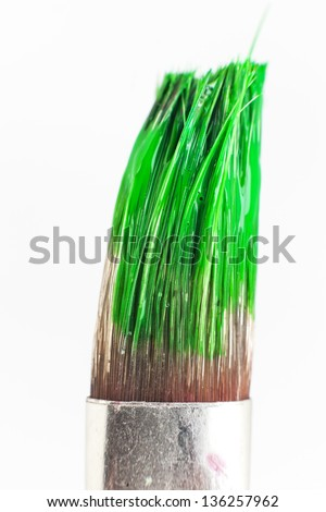 paint brush with green paint on white background