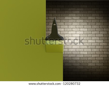 Paint brush with green stroke on the brick wall