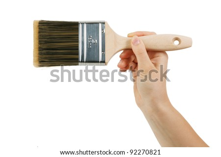 Paint brush with wooden handle of a human hand - stock photo