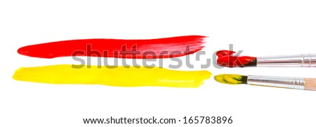 Paint brushes and paint isolated on a white background