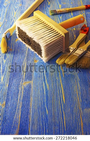 Paint brushes on a wooden platform - stock photo