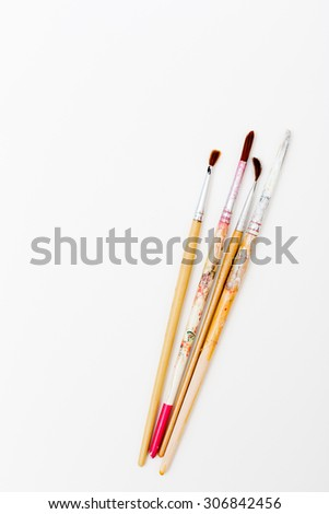 Paint brushes on art water color paper