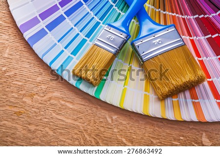 Paint brushes on pantone color palette guide maintenance concept  - stock photo