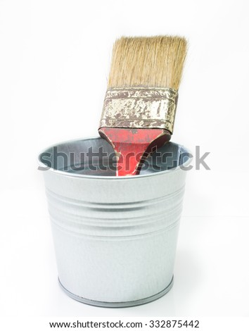 Paint brushes tool in can on white background - stock photo
