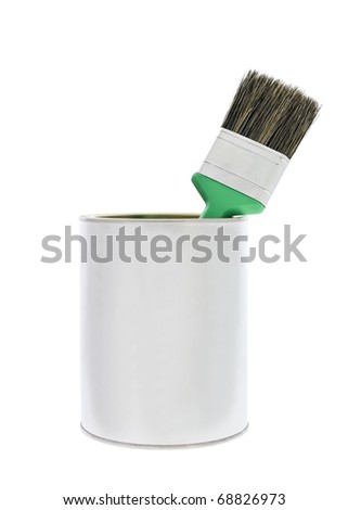 Paint can with a green brush isolated on white background - stock photo