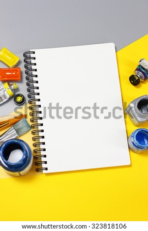 Paint, color charts and a notepad and pen, tint - stock photo