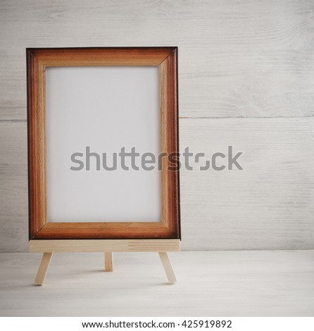 paint frame on wooden background - stock photo