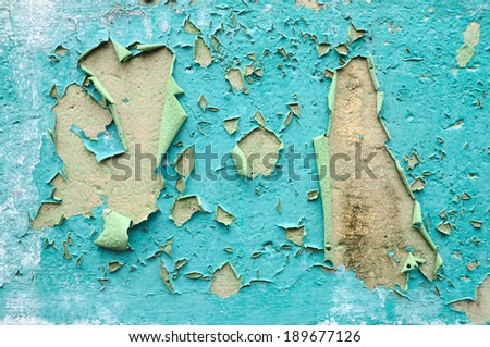 Paint is peeling off, weather-beaten wall. - stock photo