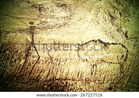 Paint of human hunting on sandstone wall, copy of prehistoric picture. Black carbon abstract children art in sandstone cave - stock photo