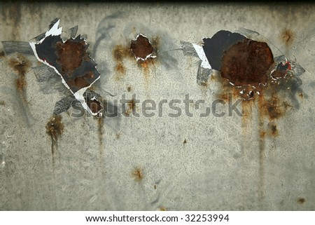 paint peeling off rusted metal - stock photo