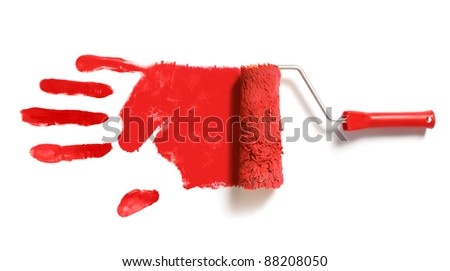 paint roller brush with red right handprint - stock photo