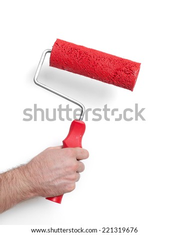 Paint roller Hand with paint roller isolated on white - stock photo