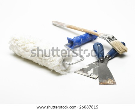 Paint roller, spatulas and paintbrush isolated on a white background - stock photo