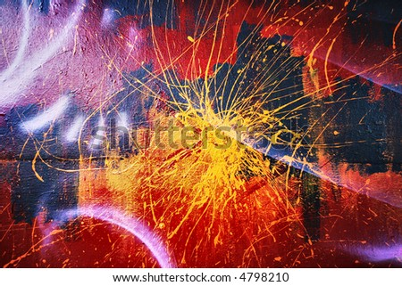 paint splattered on a wall that has given an amazing effect - stock photo