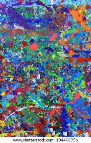 Paint splattered wall in an art studio - stock photo