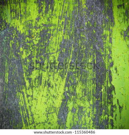Paint strokes on metal surface with leaf-like veins, close-up. - stock photo