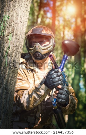 Paintball sport player - stock photo
