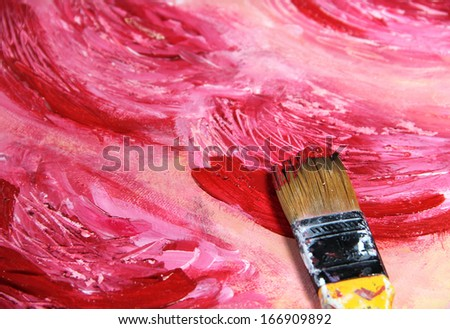 Paintbrush and beautiful painting of flowers in red and pink colors - stock photo