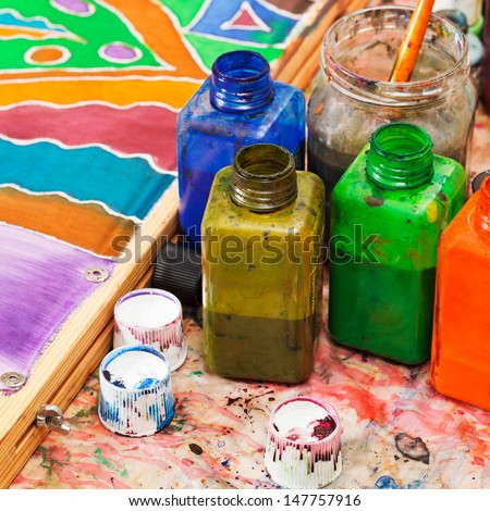 paintbrush and bottles with dyes for cold batik - stock photo