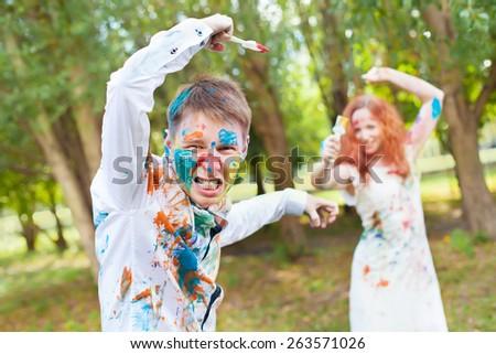 Paintbrush battle on the forest background - stock photo