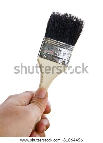 Paintbrush in hand isolated on white background