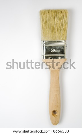 Paintbrush on a white background. Vertical shot.