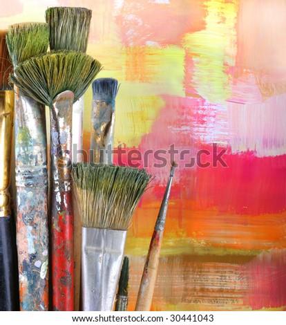 Paintbrush on painted background. - stock photo