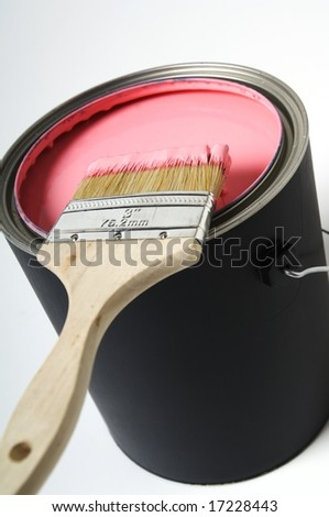 Paintbrush over paint can - stock photo