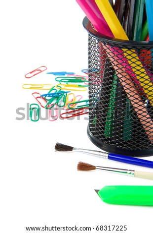 paintbrush, paper clips and pencil in holder isolated on white background - stock photo