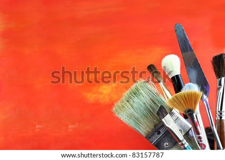 Paintbrushes against a grunge background. - stock photo