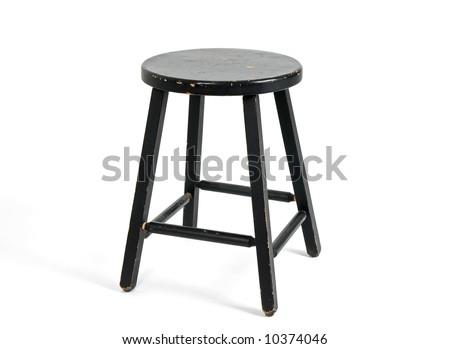 Painted black wooden stool on white background. - stock photo