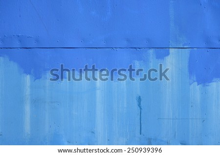 painted blue metal with rivets - stock photo