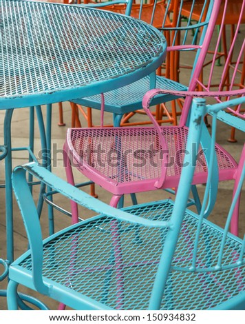 painted colorful cafe chairs - stock photo