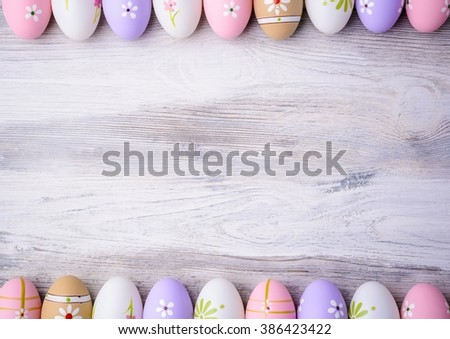 Painted colorful Easter eggs with copy space on grey wooden background Top view. Flat lay. Easter concept. Happy Easter ! - stock photo