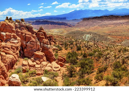 Painted Desert Colorful Yellow Grass Lands Orange Sandstone Red Fiery Furnace Arches National Park Moab Utah USA Southwest. - stock photo